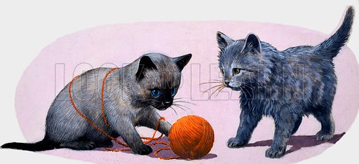 Kittens playing with a ball of wool.