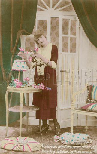 Girl arranging flowers.