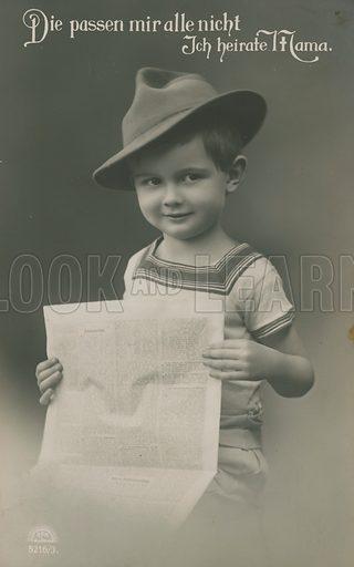 German boy, reading newspaper. Postcard sent in 1913.