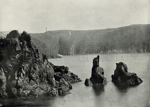 """Guernsey, Moulin Huet Bay, with the """"Dog and Lion"""" Rocks. Photograph from Round the Coast (George Newnes, 1895)."""