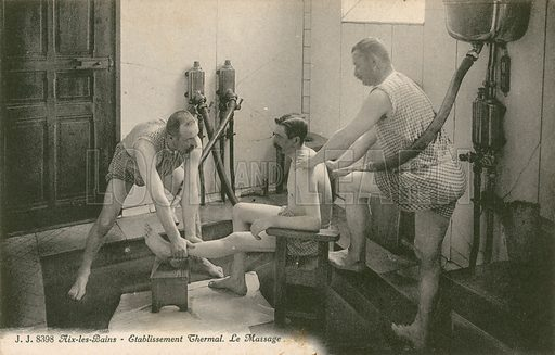 Man being massaged by two men in the thermal bath at Aix les Bains