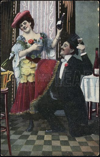 A well-dressed couple pictured laughing as the woman holds a bottle of wine, with the man raising his glass.