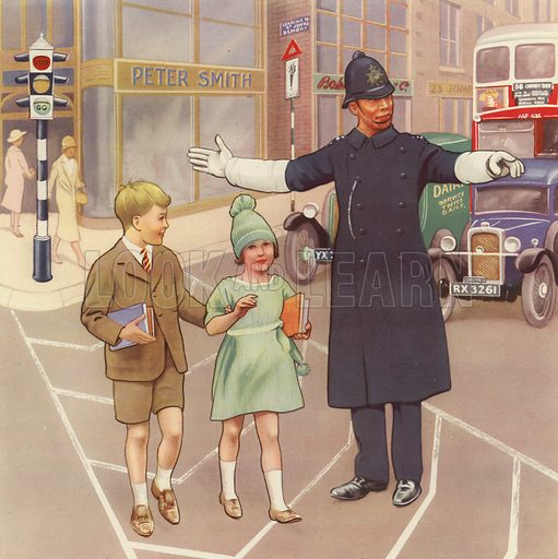 Policeman helping children across the road