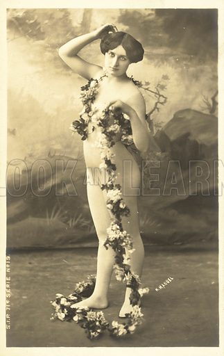 Girl in body stocking holding garland of flowers