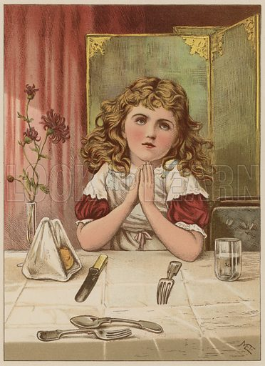 Girl saying grace before meal