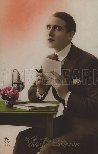 Young man writing a letter