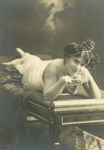 Woman leaning on her elbows with pearls in her hair