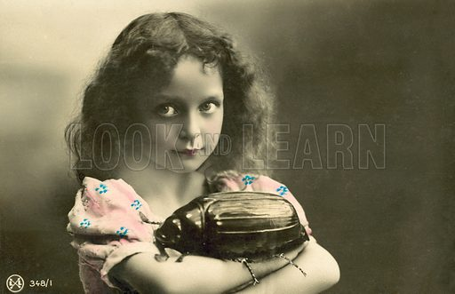 Little girl with a giant stag beetle