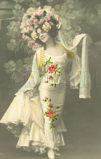 Woman with a headdress of flowers. Postcard, early 20th century.