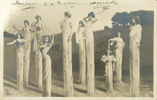 Women on stilts dressed as asparagus