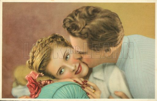 Young man kissing a pretty girl on the cheek.  Postcard, early 20th century.