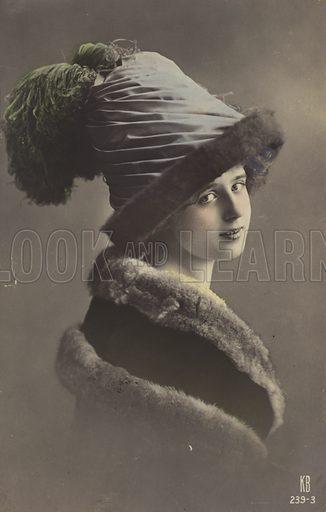 Woman in strange hat.  Postcard, early 20th century.