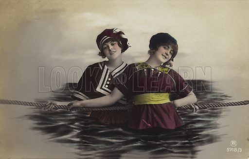 Girls having a swim, holding a rope.  Postcard, early 20th century.