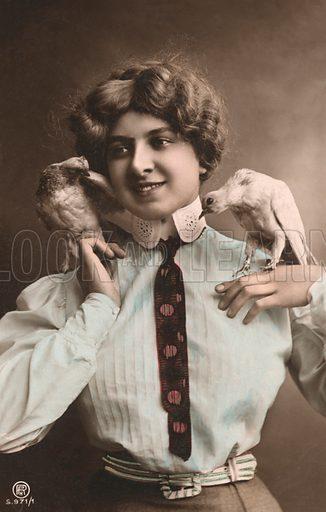 Girl holding two birds