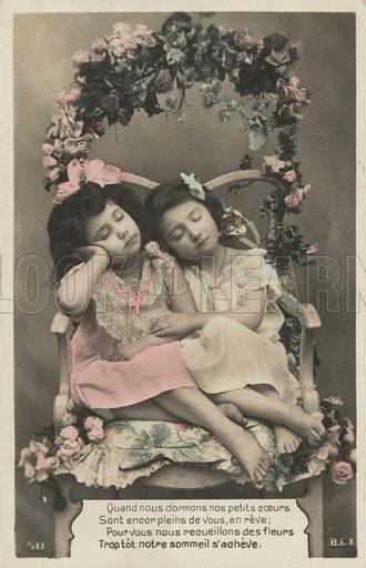 Two sleeping girls.  Postcard, early 20th century.
