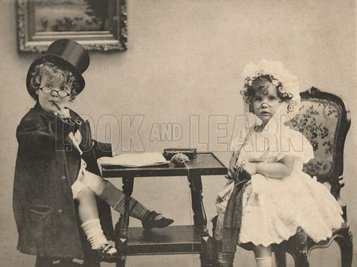 Two children dressed as an elderly couple