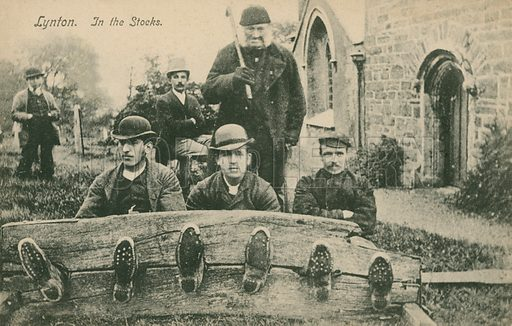 Men in the stocks at Lynton