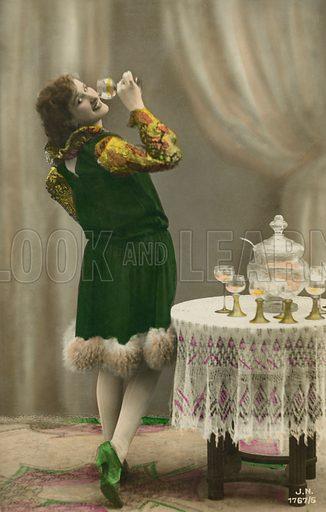 Pretty girl enjoying a glass of wine punch. Postcard, early 20th century.