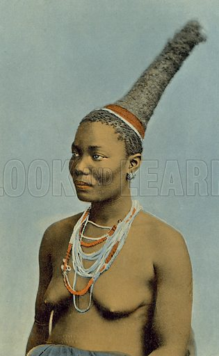 Lady poses with traditional hairdo. Postcard, early 20th century.