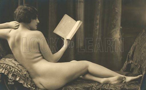 Nude reading a book