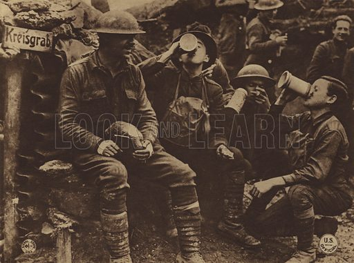 """The Germans left this trench near Consonvoye so hurriedly that 33d Division men, hot on their trail, found beer, cigars and bread in the dugouts. An informal """"Kommers"""" was held by the Yanks during a pause in the fighting. Lieutenant Karl Rheinfrank in foreground with loaf of bread in his lap. The information is that the beverage graded considerably more than 2.75. Illustration for US Official Pictures of the World War, showing America's Participation, selected from the official files of the War Department by William E Moore and James C Russell (Pictoria Bureau, 1920).  Gravure printed."""