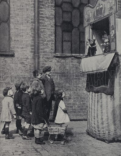Children watching a Punch and Judy show on a London street. Illustration from Peoples of the World in Pictures (Odhams Press, London, late 1930s).