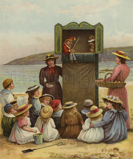 Children watching a Punch and Judy show at the beach