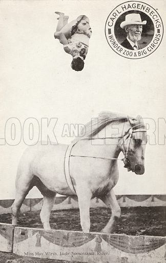 Stunt horse rider May Wirth performing a somersault, Carl Hagenbeck's Wonder Zoo and Big Circus, Olympia, London. Postcard, early 20th Century.