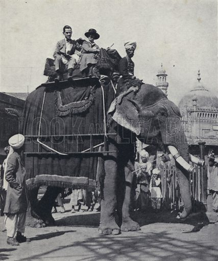 British travellers riding on an elephant, India. Illustration for India, Land of the Black Pagoda by Lowell Thomas (Hutchinson, 1931). Photographs by HA Chase and the author.