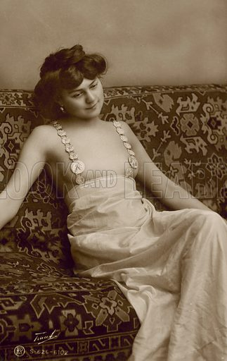 Woman wearing a risque dress. Postcard, early 20th century.