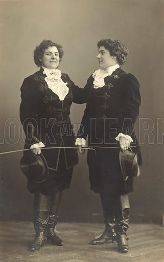 Two women in period costume. Postcard, early 20th century.
