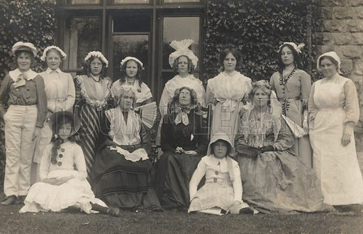 Portrait of a group of women and girls, possibly schoolteachers with their pupils. Postcard, early 20th century.