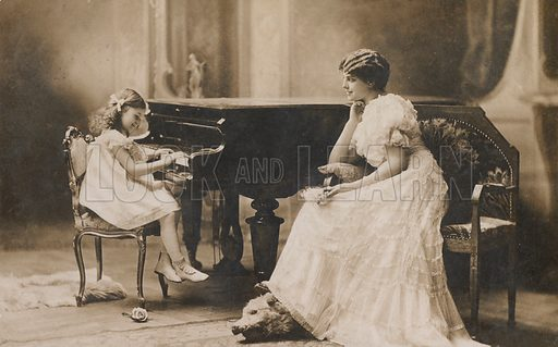 Portrait of a woman watching a young girl playing the piano. Postcard, early 20th century.