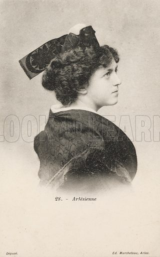 Portrait of a woman of Arles, France. Postcard, early 20th century.
