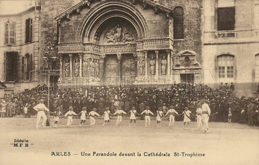 Dancers performing the Farandole outside the Church of St Trophime, Arles, France. Postcard, early 20th century.