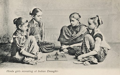 Hindu girls playing a game of Indian draughts. Postcard, early 20th century.