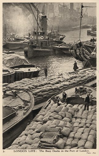 Boats and barges in the busy docks of the port of London. Postcard, early 20th century.