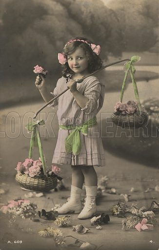 Portrait of a young girl carrying baskets of flowers. Postcard, early 20th century.