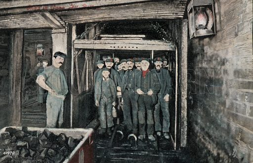Group of miners in a lift cage in coal mine. Postcard, early 20th century.