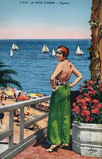 Woman posing by the seafront on the Cote D'Azur, France. Postcard, early 20th century.