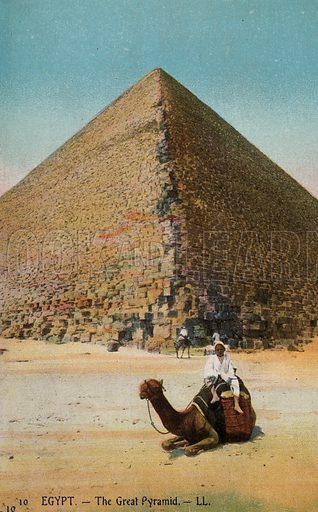 Man on a camel in front of the Great Pyramid ogf Giza, Egypt. Postcard, early 20th century.