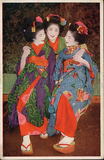 Three young Japanese women in traditional costume. Postcard, early 20th century.