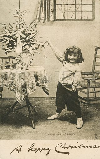 An excited young child on Christmas morning. Christmas greeting. Postcard, early 20th century.