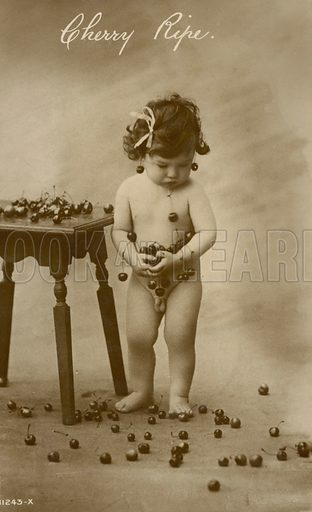 Young boy with cherries. Postcard, early 20th century.