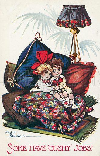 A boy and girl cuddling amongst cushions. Postcard, early 20th century.