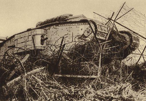 British tank attempting to break through a barbed wire obstacle, World War I, 1917-1918. Illustration from Der Weltkrieg im Bild (Verlag Der Weltkrieg Im Bild, Munich, c1928).