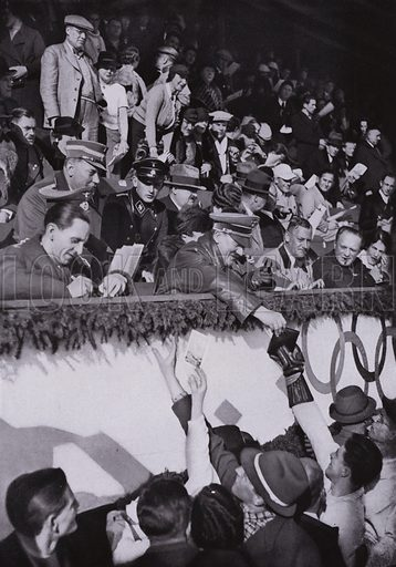 Nazi leaders Adolf Hitler and Joseph Goebbels signing autographs for members of the Canadian team in the ice skating arena at the Winter Olympic Games in Garmisch-Partenkirchen, Germany, 1936. Illustration from Die Olympischen Spiele 1936 (Cigaretten-Bildendienst Hamburg-Bahrenfeld, 1936).