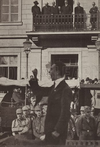 Nazi Party politician Joseph Goebbels making a speech in Bad Freienwalde, Brandenburg, Germany, watched by the town's Social Democratic Party Mayor from the balcony in the background, 1929. Illustration from Zeitgeschichte in Wort und Bild, by George Soldan (National-Archiv Verlags GMBH, Munich, 1933).