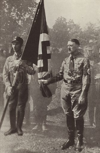 Nazi Party leader Adolf Hitler holding the Blutfahne (Blood Flag) carried at the Munich Beer Hall Putsch of 1923. Illustration from Zeitgeschichte in Wort und Bild, by George Soldan (National-Archiv Verlags GMBH, Munich, 1933).