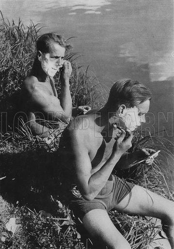 Two Nazi German workers of the Reich Labour Service (RAD) shaving on a riverbank before a trip into town. Illustration from Arbeitsmanner des Fuhrers, by Gustav von Estorff (Zeitgeschichte Verlag, Wilhelm Andermann, Berlin, 1939).